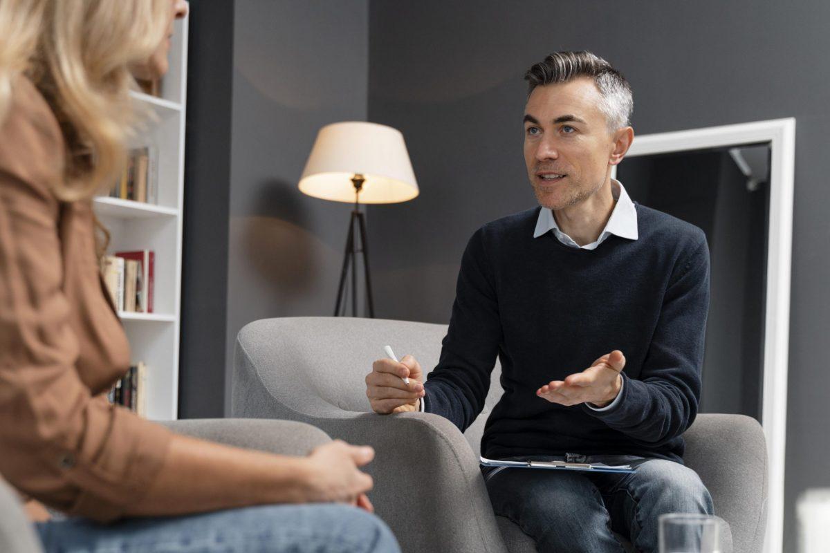 mid-shot-patient-talking-man-therapist